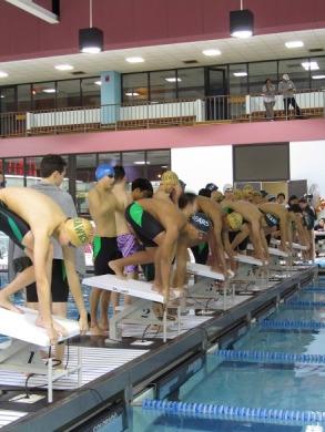 Albert Ang, Shay Mallick, Nikita Kartashov prepare to compete at a swim meet in East Brunswick.